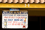 Sign identifying a painter's workshop at the Village Artisanal de Ouagadougou, a cooperative that employs dozens of artisans who work in different mediums, in Ouagadougou, Burkina Faso, on Monday November 3, 2008.