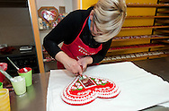 Traditional gingerbread maker Brankica Šćuric decorates a large gingerbread heart, in her workshop in Marija Bistrica, Croatia. The traditional gingerbread craft of northern Croatia is inscribed on the UNESCO list of Intangible Cultural Heritage © Rudolf Abraham