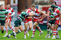 Gloucester Inside Centre (#12) Billy Twelvetrees is tackled by London Irish Fly-Half (#10) Shane Geraghty during the first half of the match - Photo mandatory by-line: Rogan Thomson/JMP - Tel: Mobile: 07966 386802 15/12/2012 - SPORT - RUGBY - Kingsholm Stadium - Gloucester. Gloucester Rugby v London Irish - Amlin Challenge Cup Round 4.