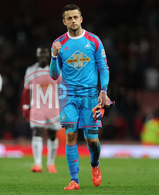 Swansea City's Lukasz Fabianski puts his fist in the air to celebrate at full time. - Photo mandatory by-line: Alex James/JMP - Mobile: 07966 386802 - 11/05/2015 - SPORT - Football - London - Emirates Stadium - Arsenal v Swansea City - Barclays Premier League