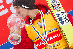Winner of Overall flying classification Gregor Schlierenzauer of Austria celebrates during trophy ceremony after the Flying Hill Individual Event at 4th day of FIS Ski Jumping World Cup Finals Planica 2013, on March 24, 2013, in Planica, Slovenia. (Photo by Vid Ponikvar / Sportida.com)
