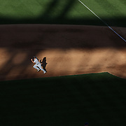 Andy Dirks, Detroit Tigers, runs to second base on a hit in the late afternoon sunshine as shadows fall on Citi Field during the New York Mets V Detroit Tigers Baseball game at Citi Field, Queens, New York. USA. 24th August 2013. Photo Tim Clayton