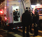 Dec. 4, 2014 - Manhattan, NY. Protestors who blocked the intersection at Broadway and 96th Street in the wake of the non-indictment in the Eric Garner death are arrested and await booking. 12/4/14 Photograph by Jake Becker/NYCity Photo Wire