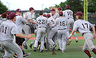 Holy Cross players celebrate on the field after defeating Gill St. Bernard's to win the NJSIAA South Jersey Non-Public B championship baseball game Tuesday June 7, 2016 at Rutgers University in Piscataway, New Jersey.  (Photo by William Thomas Cain)