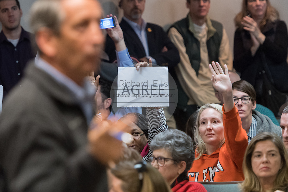 Constituents try to ask questions of U.S. Rep. Mark Sanford , right, during a heated town hall meeting February 18, 2017 in Mount Pleasant, South Carolina. Hundreds of concerned residents turned up for the meeting to address their opposition to President Donald Trump during a vocal meeting held by U.S. Rep. Mark Sanford and Senator Tim Scott.