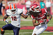 FAYETTEVILLE, AR - SEPTEMBER 5:  Keon Hatcher #4 of the Arkansas Razorbacks is tackled by his hair by Adrian Hynson #12 of the UTEP Miners at Razorback Stadium on September 5, 2015 in Fayetteville, Arkansas.  The Razorbacks defeated the Miners 48-13.  (Photo by Wesley Hitt/Getty Images) *** Local Caption *** Keon Hatcher; Adrian Hynson