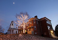 Montgomery, New York - A tree is decorated with holiday lights in front of the Montgomery Village Hall and  library on  Dec. 14, 2010. The brick structure, built in 1818, was originally the Montgomery Academy. The First Presbyterian Church is at left.