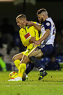 Gary Deegan of Southend United (right) puts Lewis Alessandra of Plymouth Argyle (left) under pressure during the Sky Bet League 2 match at Roots Hall, Southend<br /> Picture by David Horn/Focus Images Ltd +44 7545 970036<br /> 10/01/2015
