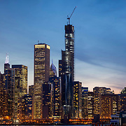 Chicago's Vista Tower under construction as of March 2019. View from edge of Navy Pier at dusk looking westward.