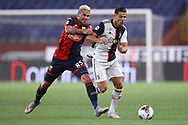 Juventus's Portuguese striker Cristiano Ronaldo takes on Genoa's Swiss midfielder Valon Behrami during the Serie A match at Luigi Ferraris, Genoa. Picture date: 30th June 2020. Picture credit should read: Jonathan Moscrop/Sportimage