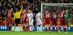 LIVERPOOL, ENGLAND - Tuesday, April 24, 2018: Liverpool's James Milner is shown a yellow card by referee Felix Brych after he awarded AS Roma a penalty during the UEFA Champions League Semi-Final 1st Leg match between Liverpool FC and AS Roma at Anfield. (Pic by David Rawcliffe/Propaganda)