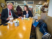 08 JANUARY 2020 - NEVADA, IOWA: Former Governor WILLIAM WELD (R-MA) talks to KIMBERLY STEPHENS, from Nevada, IA, while her son, AJ STEPHENS, 5, plays on his tablet computer, during a campaign stop at Farm Grounds, a coffee shop in Nevada. Weld, who was a two term Republican Governor of Massachusetts, is campaigning in Iowa in support of his primary challenge of Republican incumbent President Donald Trump.       PHOTO BY JACK KURTZ