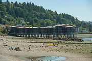 2017 JULY 25 - Harbor West Apartments at low tide at Alki Beach seen from near Constellation Park, Seattle, WA, USA. By Richard Walker