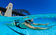 Underwater split level view of a swimmer in a North Sydney harbour bridge public swimming pool. Sydney. Australia.