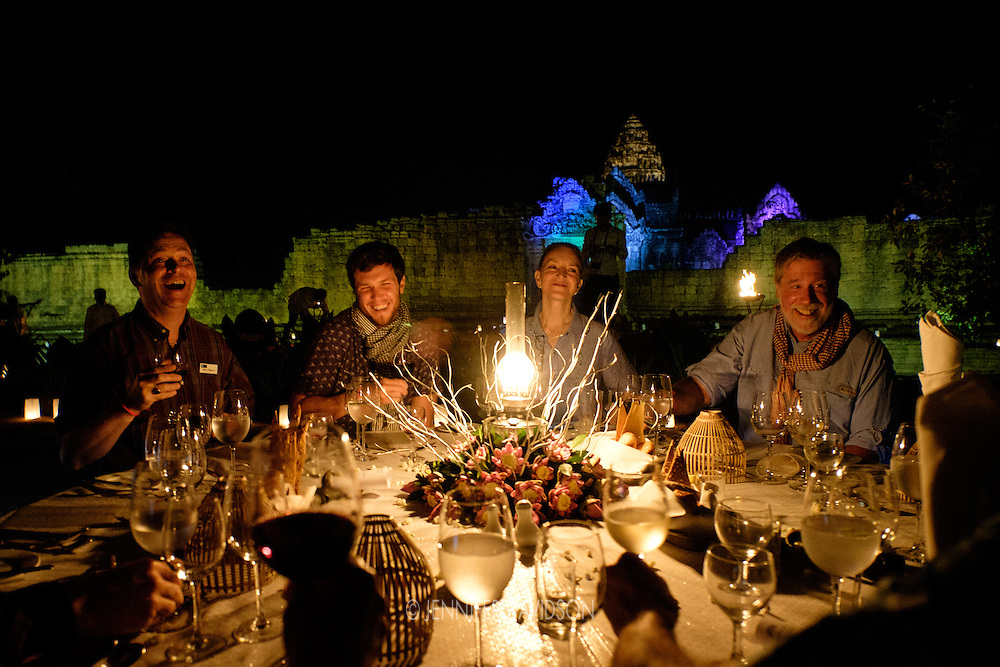 Guests on a Lindblad-National Geographic Expedition propose a toast during a private dinner at Banteay Samre, an Angkor temple and UNESCO World Heritage Site near Siem Reap, Cambodia.