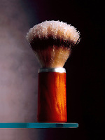Still life of a submerged shaving brush.