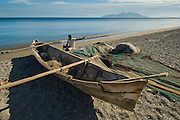 Fisherman and canoe, Gading Beach, Maumere, Flores