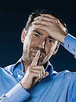 caucasian man unshaven headache portrait isolated studio on black background