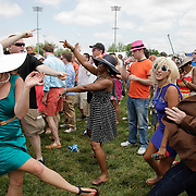 Infield fans dance to music at the Oak St. Production Group tent at the 138th running of the Kentucky Derby at Churchill Downs in Louisville, Ky. Saturday May 5, 2012.  Photo by David Stephenson