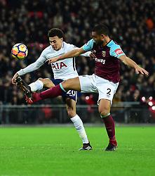 Dele Alli of Tottenham Hotspur battles for the ball with Winston Reid of West Ham United - Mandatory by-line: Alex James/JMP - 04/01/2018 - FOOTBALL - Wembley Stadium - London, England - Tottenham Hotspur v West Ham United - Premier League