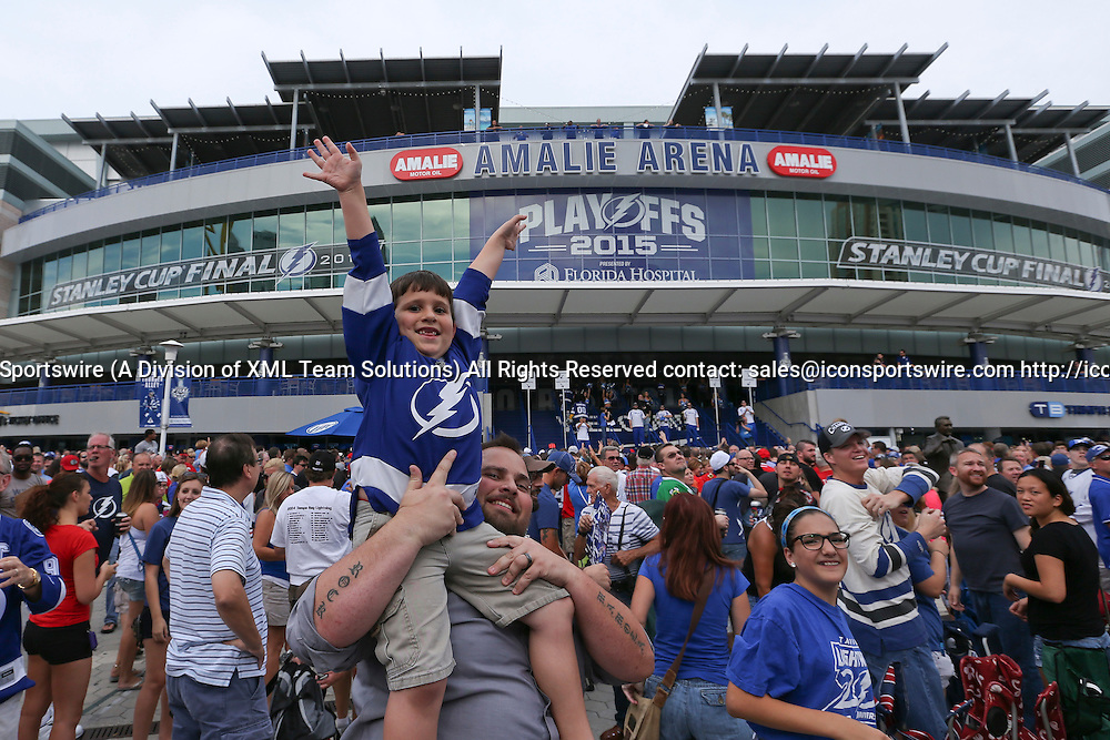 06 June 2015: A young Tampa Bay Lightning fan waits outside Amalie Arena before gates open for Game 2 of the Stanley Cup Finals between the Chicago Blackhawks and Tampa Bay Lightning at Amalie Arena in Tampa, FL.