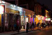 Crowded street scene and Boogie Woogie jazz music club in famous Bourbon Street in French Quarter of New Orleans, USA