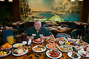 Carson 'Collard Green' Hughes eating at an all you can eat seafood buffet in Newport News, Virginia, in preparation for a contest. He died at 44 in December 2008. MODEL RELEASED.