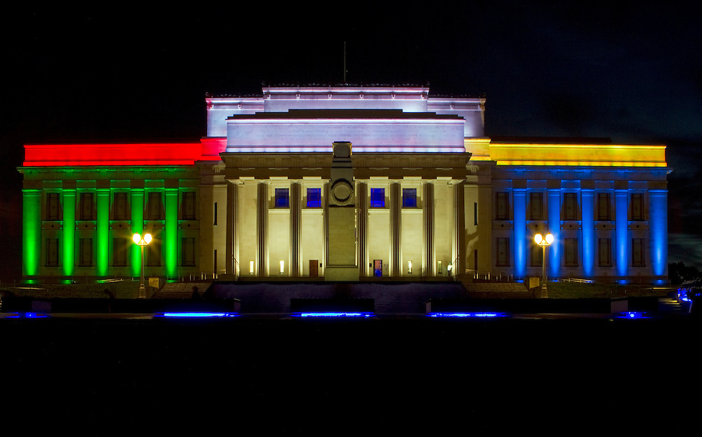 Auckland War Memorial Museum illuminated in blue, green, red and yellow to reflect the South African flag marking the death of Nelson Mandela, Auckland, New Zealand, Friday, December 06, 2013.   Credit: SNPA / David Rowland