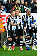 Newcastle United forward Dwight Gayle (#9) celebrates the second Newcastle United goal with goalscorer Newcastle United midfielder Matt Ritchie (#11) during the EFL Sky Bet Championship match between Newcastle United and Wigan Athletic at St. James's Park, Newcastle, England on 1 April 2017. Photo by Craig Doyle.