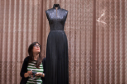 "© Licensed to London News Pictures. 09/05/2018. LONDON, UK.  A visitor at the preview of ""Azzedine Alaïa:  The Couturier"", the first UK exhibition of Azzedine Alaïa examining the work of one of the most respected fashion designers in history.  Over 60 rare and iconic garments are on display alongside a series of specially commissioned pieces.  The exhibition runs 10 May to 7 October 2018 at the Design Museum.  Photo credit: Stephen Chung/LNP"