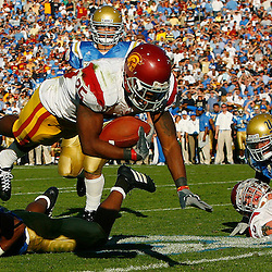 USC vs UCLA at the Rose Bowl in Pasadena December 2. 2006, USC's C.J. Gable ,25, dives for a TD in the 2nd quarter against UCLA. <br /> (SGVN Staff Photo Keith Birmingham SXSports)
