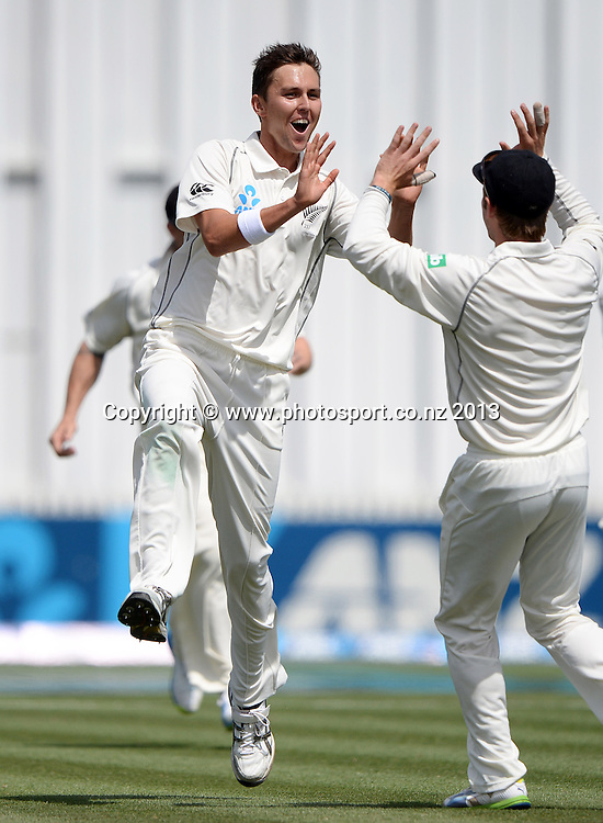 Trent Boult celebrates the wicket of Kieran Powell on Day 3 of the 3rd cricket test match of the ANZ Test Series. New Zealand Black Caps v West Indies at Seddon Park in Hamilton. Saturday 21 December 2013. Photo: Andrew Cornaga / www.Photosport.co.nz