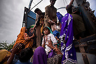 Flood-displaced families fleeing rising floodwaters, climb into a truck to take them to higher ground, on 14 September, 2011, in Khoski, Pakistan. More than 17% of children in the flood areas are severely acutely malnourished and 67% of livestock has been destroyed after torrential monsoon rains, reminiscent of the 2010 floods that devastated Pakistan, have reportedly already killed over 200 people, left 300,000 homeless and affected over 7 million. (Photo by Warrick Page)