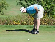 9/23/15 – Boston, MA – After missing his putt by a matter of inches, Michael Lefkowitz bends over in exasperation at the Newbury Invitational on Wednesday, Sep. 23, 2015. (Evan Sayles / The Tufts Daily)