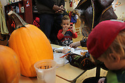 25 October 2013. Manhattan, New York. West Side Family Preschool, 63 W 92nd St. Gio and Julius at West Side Family Preschool. Julius has major separation anxiety about his father, and generally needs him nearby in order to stay comfortable. 10/25/13. Photograph by Nathan Place/NYCity Photo Wire