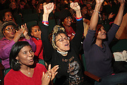 November 6, 2012- Harlem, NY:  Audience cheers at the U.S. Presidential Election Watch Party held at the Schomburg Center for Research in Black Culture on November 6, 2012 in Harlem, New York City. The Schomburg Center for Research in Black Culture, a research unit of The New York Public Library, is generally recognized as one of the leading institutions of its kind in the world. For over 80 years the Center has collected, preserved, and provided access to materials documenting black life, and promoted the study and interpretation of the history and culture of peoples of African descent. (Terrence Jennings)