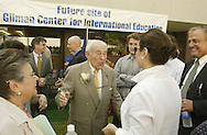 Ben Gilman, center, greets people before the start of the groundbreaking ceremony for SUNY Orange's planned Gilman Center for International Education on the college's Middletown campus on Aug. 2, 2007. His wife Georgia  is at left.