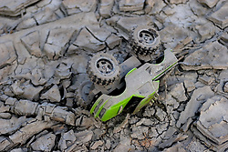30 Sept, 2005.  New Orleans, Louisiana. Lower 9th ward. Hurricane Katrina aftermath. <br /> The remnants of the lives of ordinary folks, now covered in mud as the flood waters recede. A child's toy car lies in the mud.<br /> Photo; ©Charlie Varley/varleypix.com