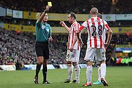 Picture by Paul Chesterton/Focus Images Ltd +44 7904 640267.03/11/2012.Andy Wilkinson of Stoke is adjudged to have fouled Robert Snodgrass of Norwich and gets a yellow card from Referee Andre Marriner. The resulting free kick leads to  the winning goal during the Barclays Premier League match at Carrow Road, Norwich.