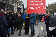 A day after Commons Speaker John Bercow announced his refusal to accept Prime Minster Theresa May's third Brexit Meaningful Vote, a Brexiteer holds a sign about parliament's contemptuous treatment of its people, on 19th March 2019, in London, England.