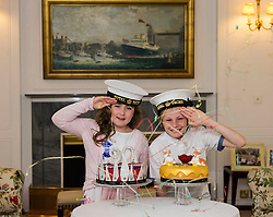 Pictured: Lucy Kearney (8) and Alfie Bennet (11)<br /> <br /> Chefs Tom Kitchin and Vicki Tighe presented primary pupils Alfie Bennet and Lucy Kearney with nine-inch versions of their winning entries for the &quot;Design a Cake for The Queen's 90th Birthday&quot; competition on the Royal Yacht Britannia today. <br /> Ger Harley | EEm 10 June 2016