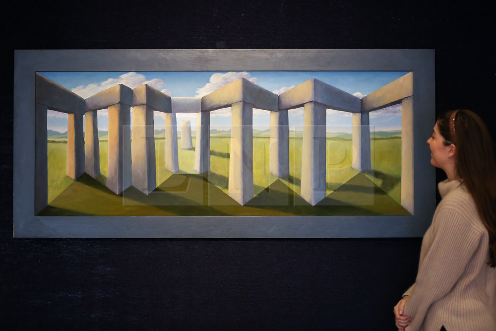 "© Licensed to London News Pictures. 12/11/2018. London, UK. A staff member looks at ""Hughes Henge"" by Patrick Hughes (Born 1939) oil on board construction (Estimate £12,000-18,000).<br /> Bonhams Modern British and Irish Art photocall. Auction to be held on 14 November 2018. Photo credit: Dinendra Haria/LNP"