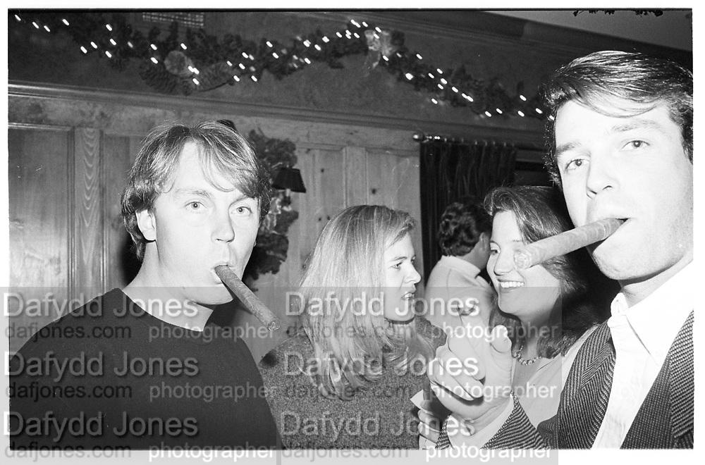 Caribou Club in Aspen, Colorado,  men with cigars, 1995© Copyright Photograph by Dafydd Jones 66 Stockwell Park Rd. London SW9 0DA Tel 020 7733 0108 www.dafjones.com