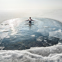 Russian Orthodox Christians immerse themselves in Lake Baikal on the day of the Epiphany.