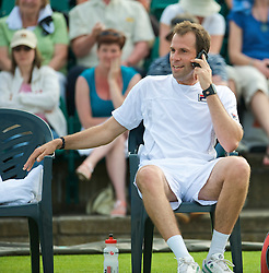 NOTTINGHAM, ENGLAND - Friday, June 12, 2009: Greg Rusedski (GBR) takes a call on his mobile phone on day two of the Tradition Nottingham Masters tennis event at the Nottingham Tennis Centre. (Pic by David Rawcliffe/Propaganda)