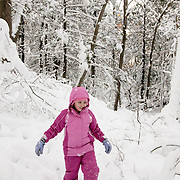 9 year old girl wearing snowshoes to hike through 2 feet of fresh snow in Breakheart Reservation, Massachusetts