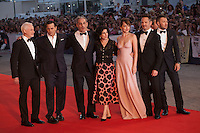 Producer Patrick McCormick, actor Johnny Depp, producer John Lesher, Sue Kroll, actress Dakota Johnson, director Scott Cooper, Joel Edgerton at the gala screening for the film Black Mass at the 72nd Venice Film Festival, Friday September 4th 2015, Venice Lido, Italy.