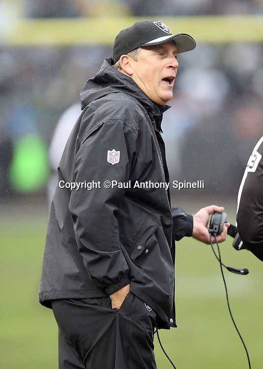Oakland Raiders head coach Jack Del Rio complains to an official during the 2015 week 15 regular season NFL football game against the Green Bay Packers on Sunday, Dec. 20, 2015 in Oakland, Calif. The Packers won the game 30-20. (©Paul Anthony Spinelli)