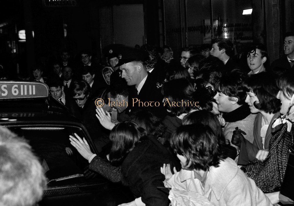 The Rolling Stones Charlie is my Darling - Ireland 1965..The Rolling Stones surrounded by fans during their visit to Dublin at the Adelphi Theatre, Middle Abbey Street, Dublin. This was the band's first Irish tour of 1965...07/01/1965.01/07/1965.07 January 1965..Wedding gifts  of Limited Edition Prints of Andrew Loog Oldham, The Rolling Stones, Charlie is my Darling – Ireland 1965.  <br />