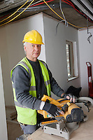 Portrait of middle-aged worker at construction site